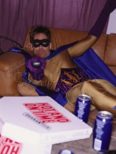 Superhero relaxing at home